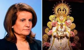 La ministra Fátima Báñez y la virgen del Rocío