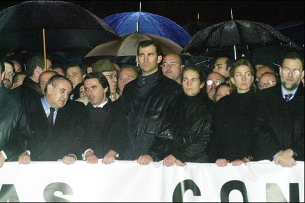 La cabecera de la manifestación 11M en Madrid, pasada por agua.