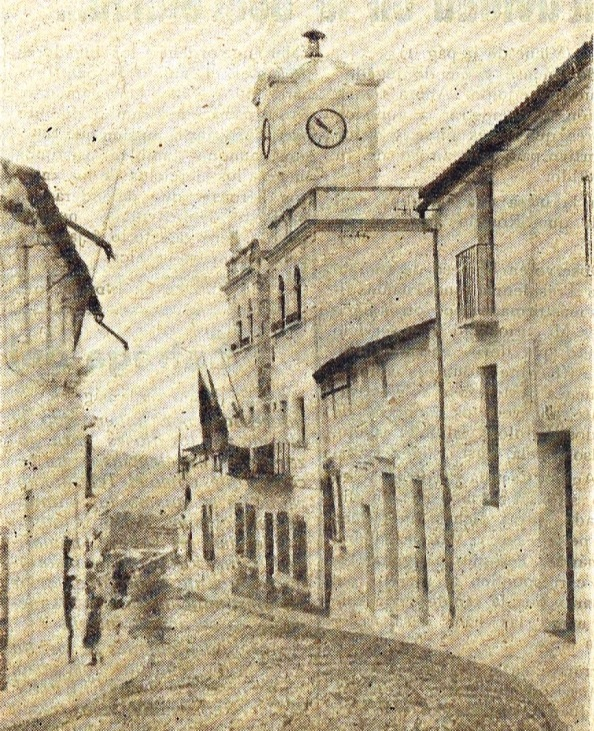 Ayuntamiento de Jimena y tramo de calle Sevilla, entonces de josÉ Antonio. Agosto 1957.